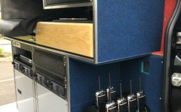 Rack charger solution for fitment into Sky TV vehicles